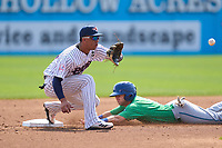 Somerset Patriots shortstop Oswald Peraza (30) waits for a pickoff attempt throw as Max George (14) steals second base during a game against the Hartford Yard Goats on September 12, 2021 at TD Bank Ballpark in Bridgewater, New Jersey.  (Mike Janes/Four Seam Images)