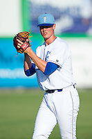 Burlington Royals starting pitcher Scott Blewett (36) warms up in the outfield prior to the game against the prior to the game against the Princeton Rays at Burlington Athletic Park on July 11, 2014 in Burlington, North Carolina.  The Rays defeated the Royals 5-3.  (Brian Westerholt/Four Seam Images)