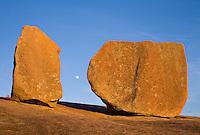 Enchanted Rock - moon rising between boulders.<br /> <br /> Canon EOS 5D, 50mm f/1.8 lens