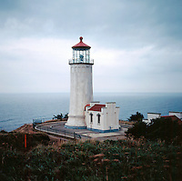 Cape Disappointment lighthouse overlooks Pacific Ocean coast. Ilwaco Washington.
