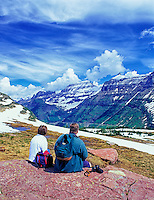 Couple enjoying view near Logan Pass. Glacier National Park, Montana.