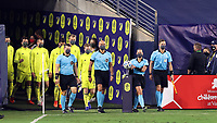 NASHVILLE, TN - SEPTEMBER 23: Referee Tori Penso grabs the match ball while she and assistant referees Logan Brown and Jeremy Hanson and fourth official Robert Sibiga lead the starters for Nashville and DC onto the field before a game between D.C. United and Nashville SC at Nissan Stadium on September 23, 2020 in Nashville, Tennessee.
