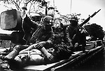 Dying U.S. Marine carried by tank through the ruins of the Citadel during the Têt offensive, Battle of Hué, Vietnam, February 1968
