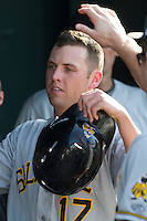 Salt Lake Bees outfielder Peter Bourjos (17) is greeted in the dugout after scoring during the Pacific Coast League baseball game against the Round Rock Express on August 10, 2013 at the Dell Diamond in Round Rock, Texas. Round Rock defeated Salt Lake 9-6. (Andrew Woolley/Four Seam Images)