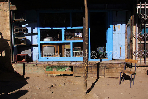 Kabul, Afghanistan<br /> November 2001<br /> <br /> A television store now open for business in central Kabul after the Northern Alliance was defeated by the Northern Alliance. The Taliban forbid the use or ownership of a TV or radio during their rule of the country.