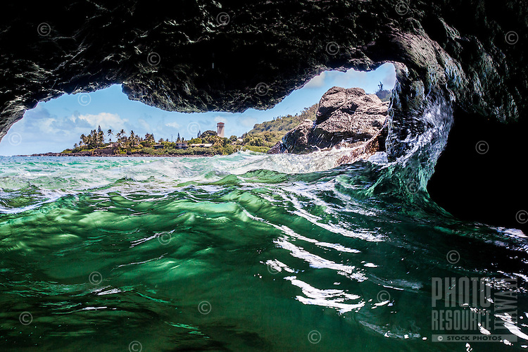 A view of the bay and coastline from the inside of a sea cave at Waimea Bay, North Shore, O'ahu.