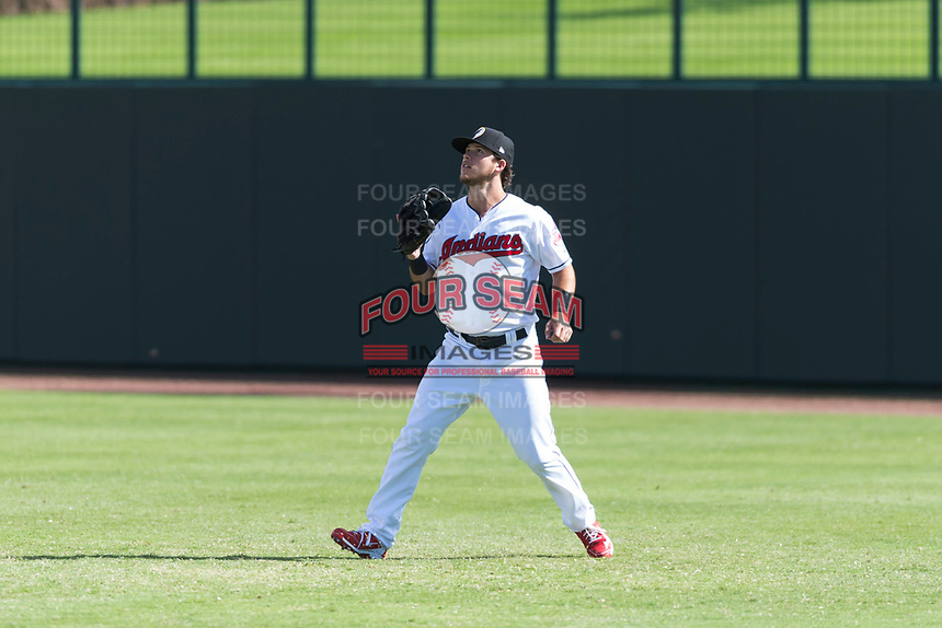 Glendale Desert Dogs right fielder Connor Marabell (4), of the Cleveland Indians organization, tracks a fly ball during an Arizona Fall League game against the Scottsdale Scorpions at Camelback Ranch on October 16, 2018 in Glendale, Arizona. Scottsdale defeated Glendale 6-1. (Zachary Lucy/Four Seam Images)