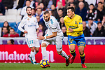 Karim Benzema of Real Madrid (L) fights for the ball with Joaquin Navarro Jimenez, Ximo, of UD Las Palmas (R) during the La Liga 2017-18 match between Real Madrid and UD Las Palmas at Estadio Santiago Bernabeu on November 05 2017 in Madrid, Spain. Photo by Diego Gonzalez / Power Sport Images