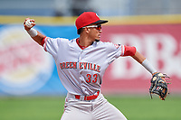 Greeneville Reds shortstop Miguel Hernandez (33) throws to first base during the first game of a doubleheader against the Princeton Rays on July 25, 2018 at Hunnicutt Field in Princeton, West Virginia.  Princeton defeated Greeneville 6-4.  (Mike Janes/Four Seam Images)