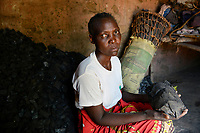ZAMBIA, Sinazongwe District, Tonga village Kangwamina, people suffer from drought and hunger, the only source of income is charcoal / nach dem dritten Duerre Jahr leiden die Menschen zunehmend an Hunger und verfallen in Lethargie, Frau von  John Siambulo, verkaufen Holzkohle als Einnahmequelle