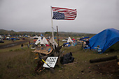 Cannon Ball, North Dakota<br /> September 23, 2016<br /> <br /> The Standing Rock Sioux encampment near the construction of the Dakota Access Pipeline stands against the construction of the new pipeline. <br /> <br /> The Standing Rock Sioux, whose tribal lands are a half-mile south of the proposed route, say the pipeline would desecrate sacred burial and prayer sites, and could leak oil into the Missouri and Cannon Ball rivers, on which the tribe relies for water.<br /> <br /> Opposition to the pipeline has drawn support from 200 Native American tribes, as well as from activists and celebrities. <br /> <br /> Energy Transfer Partners—one of the major stakeholders in the controversial Dakota Access pipeline—bought over 6,000 acres of land surrounding the line's route in North Dakota, according to several media reports over the weekend.
