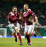 Arbroath's Steven Doris (R) celebrates after scoring from a free-kick and is chased by team-mate Danny Rennie
