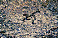 Big Island petroglyph on Pahoehoe lava, late afternoon sun, at Puu lua, Hawaii Volcanoes National Park.