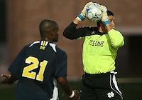 Andrew Quinn #0 of the University of Notre Dame gets the ball away from Latif Alashe #21 of the University of Michigan during a men's NCAA match at the new Alumni Stadium on September 1 2009 in South Bend, Indiana. Notre Dame won 5-0.