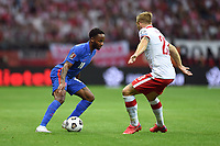 8th September 2021; PGE National Stadium, Warsaw, Poland: FIFA World Cup 2022 Football qualification, Poland versus England;  Raheem Sterling takes on Tymoteus Puchacz