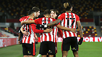 Brentford players congratulate Saman Ghoddos (No 20) after scoring their second goal during Brentford vs Sheffield Wednesday, Sky Bet EFL Championship Football at the Brentford Community Stadium on 24th February 2021