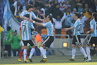 Teammates celebrate with forward Lionel Messi following Argentina's first goal. Argentina defeated South Korea, 4-1, in both teams' second match of play in Group B of the 2010 FIFA World Cup. The match was played at Soccer City in Johannesburg, South Africa June 17th.