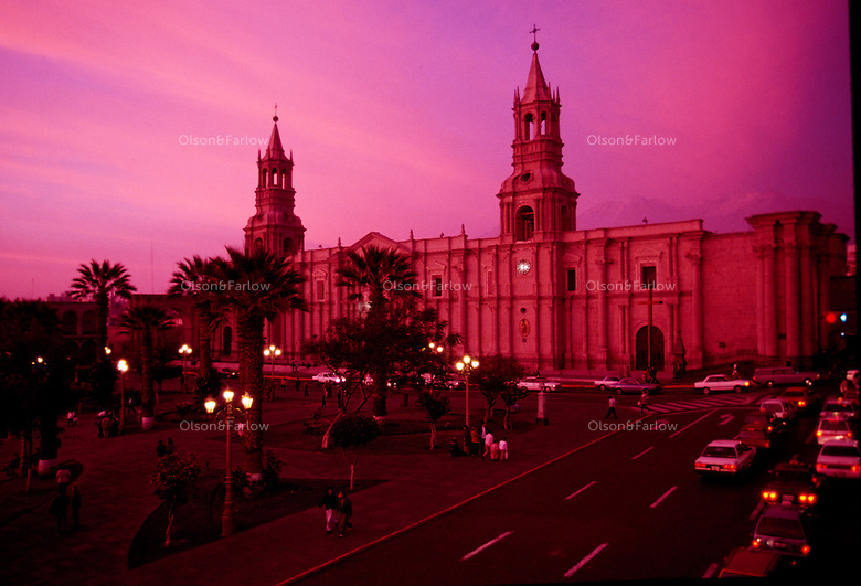 Strange light illuminates El Misti volcano rising behind the Cathedral which dominates one entire side of the Plaza de Armas in Arequipa, Peru.