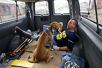 Animal rescuers from Pasados Safe Haven are photographed by photographer Karen Ducey as they save animals after Hurricane Katrina destroyed New Orleans in 2005.