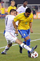 Andre Santos (6) of Brazil is defended by Alejandro Bedoya (11) of the United States. The men's national team of Brazil (BRA) defeated the United States (USA) 2-0 during an international friendly at the New Meadowlands Stadium in East Rutherford, NJ, on August 10, 2010.