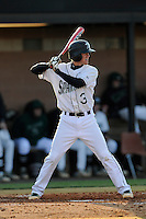 Shortstop Dylan Woods (3) of the University of South Carolina Upstate Spartans bats in a game against the UNC Asheville Bulldogs on Tuesday, March, 25, 2014, at Cleveland S. Harley Park in Spartanburg, South Carolina. (Tom Priddy/Four Seam Images)