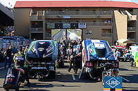 Jul, 20, 2012; Morrison, CO, USA: NHRA funny car driver Alexis DeJoria (left) and Tim Wilkerson await their qualifying chance in the staging lanes during qualifying for the Mile High Nationals at Bandimere Speedway. Mandatory Credit: Mark J. Rebilas-