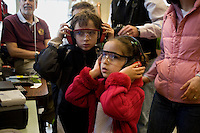 Children put on ear protectors before entering the Wright Brothers Wind Tunnel operated by the Department of Aeuronautics and Astronautics during the MIT Under the Dome open house in Cambridge, Massachusetts, USA.