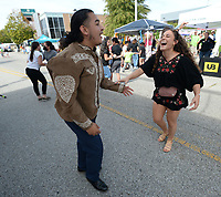 Samuel Lopez (left) and Dany Vallejo, both of Springdale laugh Saturday, Oct. 9, 2021, as they dance during the eighth annual ArkanSalsa Fest on Emma Avenue in Springdale. The event is organized by OneCommunity and features music, food, games, art, dancing and a car show. Visit nwaonline.com/211010Daily/ for today's photo gallery.<br /> (NWA Democrat-Gazette/Andy Shupe)