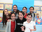 """These fifth-graders at J.P. Henderson ES spent the semester working on an art project about animals breaking out of the zoo. They call themselves """"The Girls Art Squad."""" Front row, left to right: Alexis, Melissa, Arianna. Back row: Mia, Anahi, Maria, and Ashley."""