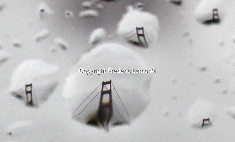 San Francisco's Golden Gate Bridge was reflected in raindrops on a car windshield. Many residents of Northern California fear flooding during a second straight day of heavy wind and rain that set rivers over their banks and flooded blocks of houses.