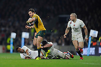 Adam Ashley-Cooper of Australia sees off Anthony Watson and Ben Morgan of England during the QBE International match between England and Australia at Twickenham Stadium on Saturday 29th November 2014 (Photo by Rob Munro)