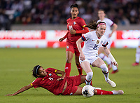 HOUSTON, TX - JANUARY 31: Yerenis De Leon #5 of Panama tries to tackle Rose Lavelle #16 of the United States during a game between Panama and USWNT at BBVA Stadium on January 31, 2020 in Houston, Texas.