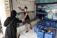 Drinking water shop in Shatila. The water running in the taps is sea water. As it s Impossible to cook or bath with seater residents of the camp have to buy fresh water. Beirut, Lebanon. August 2015