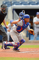 Daytona Cubs catcher Yaniel Cabezas (8) during a game against the Charlotte Stone Crabs on July 19, 2013 at Charlotte Sports Park in Port Charlotte, Florida.  The game was called in the seventh inning tied at zero due to rain.  (Mike Janes/Four Seam Images)