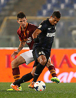 Calcio, Serie A: Roma vs Inter. Roma, stadio Olimpico, 1 marzo 2014.<br /> AS Roma defender Alessio Romagnoli, left, and FC Inter midfielder Fredy Guarin, of Colombia, fight for the ball during the Italian Serie A football match between AS Roma and FC Inter at Rome's Olympic stadium, 1 March 2014.<br /> UPDATE IMAGES PRESS/Riccardo De Luca