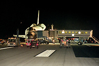 """Crew and technicians surround the orbiter after landing, Space Shuttle  Atlantis, STS 101Mission, May 2000, Kennedy Space Center, Titusville, FL.  Crew:  Commander James D. Halsell Jr., Pilot Scott J. """"Doc"""" Horowitz, Mission Specialists Mary Ellen Weber, Jeffrey N. Williams, James S. Voss, Susan J. Helms and Yury Vladimirovich Usachev.  (Photo by Brian Cleary/bcpix.com)"""