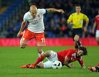 (L-R) Arjen Robben of Netherlands tackled by Joe Allen of Wales during the Wales v Netherlands  International Friendly, at Cardiff City Stadium, Cardiff, Wales, United Kingdom, 13 November 2015.