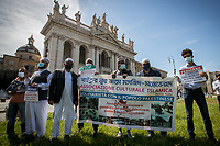 Rome, Italy. 28th May, 2021. Today, the Comunità Musulmana in Italia (Muslim Community In Italy), Pro-Palestinian activists and members of the public held a demonstration in Piazza San Giovanni to show support and solidarity to the Palestinian People and to protest against the crisis between Palestinian people and the Israeli armed forces which began on the 6th of May 2021 with the decision of the Israeli Supreme Court to evict four Palestinian families from the East Jerusalem neighborhood of Sheikh Jarrah, part of the Palestinian Territories under international law. In 15 days of Israeli bombings, the Gaza Strip alone has suffered the death of at least 248 people - including 68 children -, 1,900+ wounded, and 72,000+ people displaced. In the same 15 days of rockets launched from the Gaza Strip at least 12 people - including 2 children - were killed in Israel and 350 people were wounded. <br /> <br /> Footnotes & Links:<br /> (Source, Reuters.com ENG, 27.05.2021) U.N. Launches Investigation Into Whether Israel, Hamas Committed Crimes https://www.reuters.com/world/middle-east/un-rights-chief-bachelet-says-israeli-strikes-gaza-may-be-war-crimes-2021-05-27/