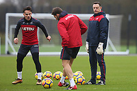 Roque Mesa of Swansea City and Angel Rangel of Swansea City are watched by Swansea City goalkeeper coach Tony Roberts during the training session before the match between Swansea City and Crystal Palace at the Fairwood Training Ground, Swansea, Wales, UK. Thursday 21 December 2017