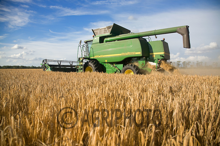 John Deere Combine Harvesting Barley In Lincolnshire