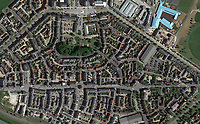 BNPS.co.uk (01202 558833)<br /> Google Maps<br /> <br /> An aerial of the roads around Poundbury in Dorset pictured without road markings or road signage. <br /> <br /> Prince Charles' Duchy of Cornwall has been accused of defying a coroner after he raised concerns about the safety of the roads in Prince Charles' designer village following the death of a motorcyclist.Dorset Assistant Coroner Brendan Allen wrote to the Duchy of Cornwall calling on them to take 'urgent action' after Richard Hallett, 25, was killed after colliding with a van in Poundbury, Dorset.The inquest heard both parties were travelling at low speed and there was 'a lack of road markings and sightlines' at the fatal junction. Charles' utopian idyll has been specifically designed with winding streets and blind bends to calm traffic, instead of conventional stop signs.Mr Allen, in his report, said the evidence he heard 'gave rise to concern' and that the Duchy of Cornwall must act 'to prevent future deaths'. But he has since received a response from them claiming there is no evidence of a 'clustering of accidents' or 'black spots' in Poundbury.Mr Hallett's mother, Tina Cooper, claimed the Duchy of Cornwall's aversion to road signs demonstrated they put 'the prettiness of the town' above saving lives.p