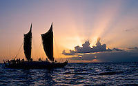 Double hulled Hawaiian sailing canoe at sunset