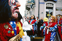 """Switzerland. Basel. Fasnacht Carnival. """"Clique""""  is a group of persons playing music in the streets during the three days of the Fasnacht Carnival. Elderly people look at the disguised crowd. © 1997 Didier Ruef"""