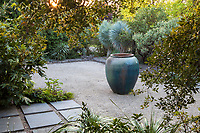 Accent pot centered in gravel entry courtyard; Kuzma Garden, Portland Oregon; design Sean Hogan. Photo MUST be credited as Design by Sean Hogan.