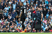 Federico Fernandez of Swansea City leaves the pitch through injury uring the Premier League match between Manchester City and Swansea City at the Etihad Stadium, Manchester, England, UK. Sunday 22 April 2018