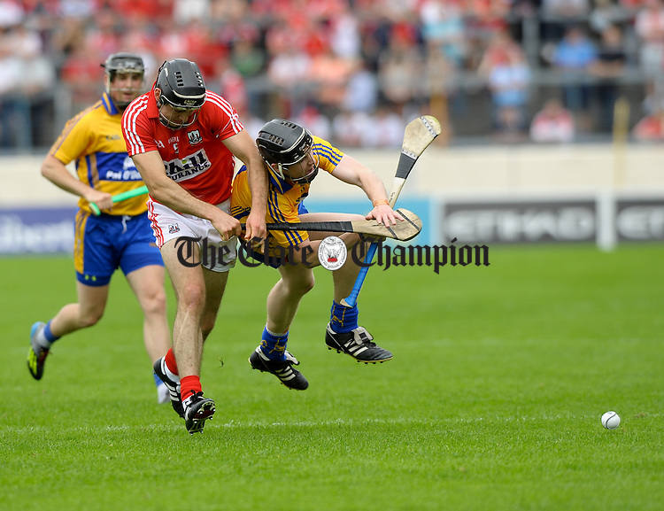 Christopher Joyce of Cork in action against Tony Kelly of Clare during the Senior hurling championship semi-final at Thurles. Photograph by John Kelly.l