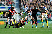 Morgan Parra of ASM Clermont Auvergne looks for support as he is tackled by Steve Borthwick of Saracens during the Heineken Cup semi-final match between Saracens and ASM Clermont Auvergne at Twickenham Stadium on Saturday 26th April 2014 (Photo by Rob Munro)