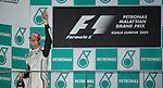 05 Apr 2009, Kuala Lumpur, Malaysia ---   Brawn GP Formula One Team driver Jenson Button of Great Britain celebrates on the podium after winning the 2009 Fia Formula One Malasyan Grand Prix at the Sepang circuit near Kuala Lumpur. Photo by Victor Fraile --- Image by © Victor Fraile / The Power of Sport Images
