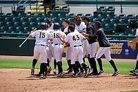 Bradenton Marauders Jesse Medrano (3) is mobbed by teammates, including Adrian Valerio (2), Gregory Polanco (48), John Bormann (15), Travis Swaggerty (12), Daniel Amaral (43), Oneil Cruz (13), and Cal Mitchell (34) after a walk off bunt base hit during a Florida State League game against the Charlotte Stone Crabs on April 10, 2019 at LECOM Park in Bradenton, Florida.  Bradenton defeated Charlotte 2-1.  (Mike Janes/Four Seam Images)