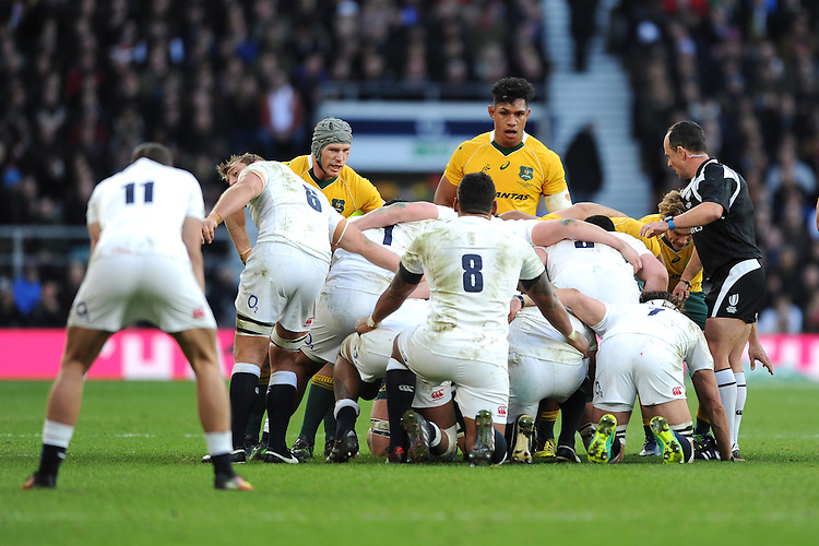 Lopeti Timani of Australia and Nathan Hughes of England keep an eye on each other at a scrum during the Old Mutual Wealth Series match between England and Australia at Twickenham Stadium on Saturday 3rd December 2016 (Photo by Rob Munro)
